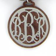 Pewter Filagree Monogram Pendant On Walnut Wood