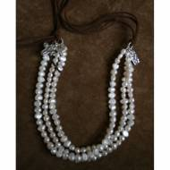 Long Necklace Of Multiple Strands Of Pearls With Leather Tassel Tie