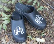 Black Leather Clogs With A White Diamond Monogram