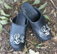 Black Leather Clog With A White Sydney Font Monogram