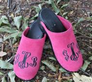 Hot Pink Suede Clogs With A Black Monogram In Victor Font