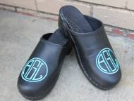 Black Leather Clogs With A Teal Monograem In Ea Circle Font