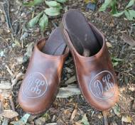 Brown Leather Clogs With Script Letters Same Size And Circle